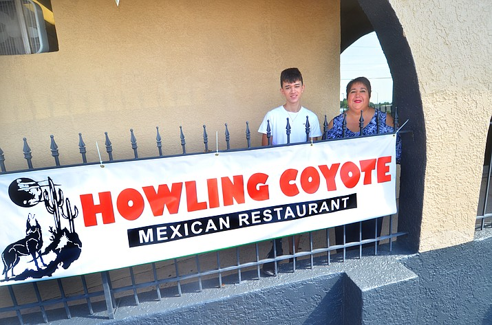 Delia Enriquezand nephew Octavio Prieto Jr. are getting ready at the Howling Coyote Cantina on Saturday, Aug. 14, 2021, for its opening this week. They are operating in the former Hacienda Inn building. (Vyto Starinskas/Independent)