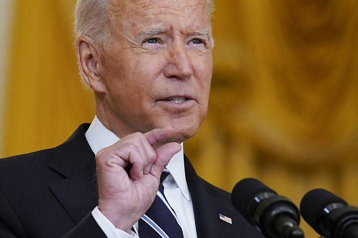 """President Joe Biden speaks from the East Room of the White House in Washington on Wednesday, Aug 18, 2021. Biden directed the nation's top education official to take action """"against governors that are trying to block and intimidate local school officials and educators"""" by prohibiting them from requiring the use of masks. (Susan Walsh/AP)"""
