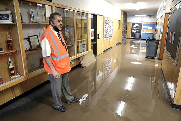 Killip Elementary School principal Joe Gutierrez looks over flooding Aug. 17 in Flagstaff. (Jake Bacon/Arizona Daily Sun via AP)