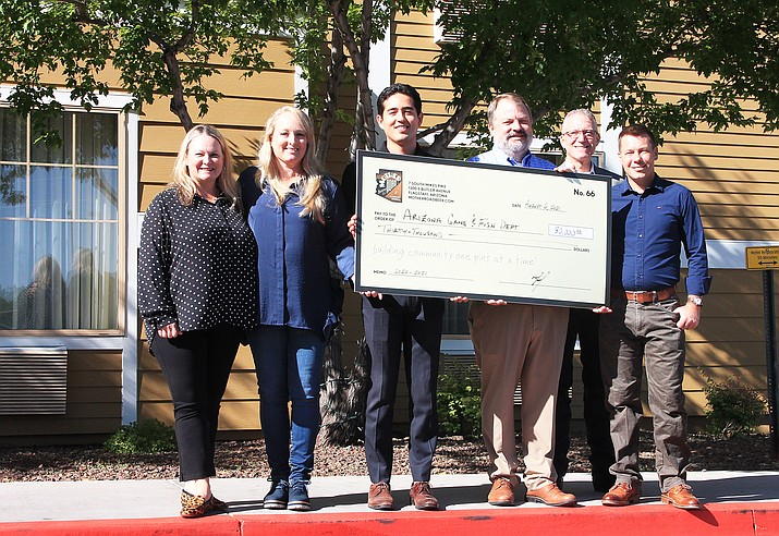 Mother Road Brewing Co. in Flagstaff presents Arizona Game and Fish a $30,000 check to be used toward on the ground conservation projects Aug. 6 in Williams. (Loretta McKenney/WGCN)
