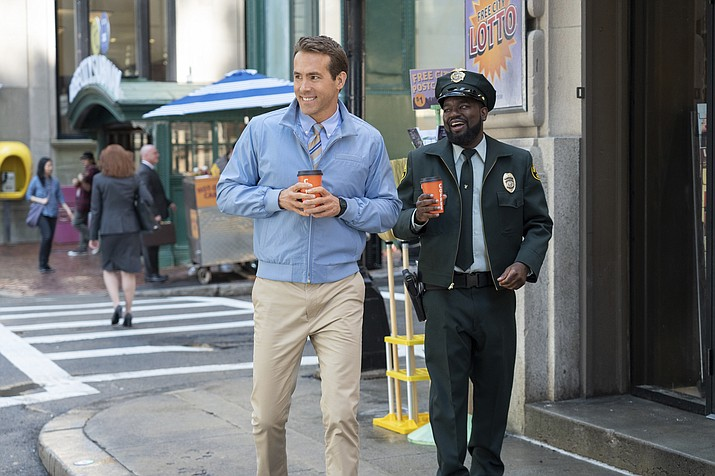 'Free Guy' stars Ryan Reynolds and Lil Rel Howery. (AP photo)