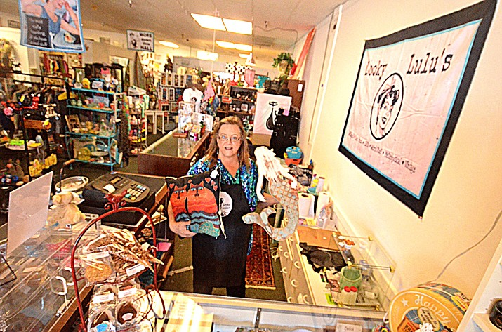 Cindy Bennett of Cottonwood, the new owner of Looky Lulu's, shows off her new store in the Sawmill Square by Safeway in Cottonwood. (Vyto Starinskas/Independent)