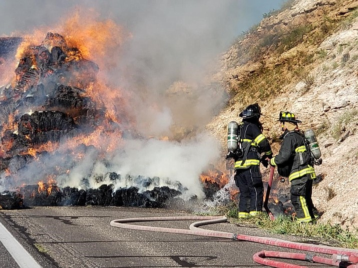 Firefighters from the Copper Canyon Fire and Medical Authority work a fire on Interstate 17 north of Camp Verde. A semi-truck carrying 25 tons of hay caught on fire and closed the northbound lanes of I-17 for more than two hours. (CCFMA/Courtesy)