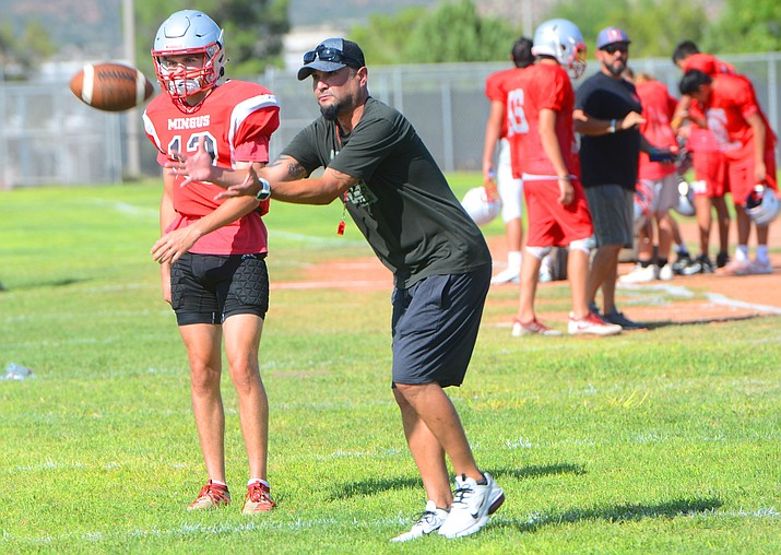 Dave Moncibaez works with Mingus football players during practice Wednesday, Aug. 25, 2021, in Cottonwood. Moncibaez has been named interim head coach of the Marauder program moving forward. (Vyto Starinskas/Independent)