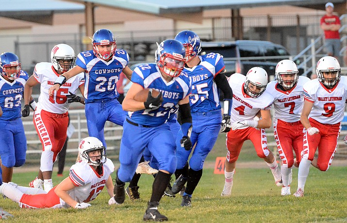 Kayden Boggess (22) runs downfield against Valley Lutheran on Friday, Aug. 27, 2021, in Camp Verde. Boggess had 15 carries for 173 yards in the 40-12 win over the Flames. (Vyto Starinskas/Independent)