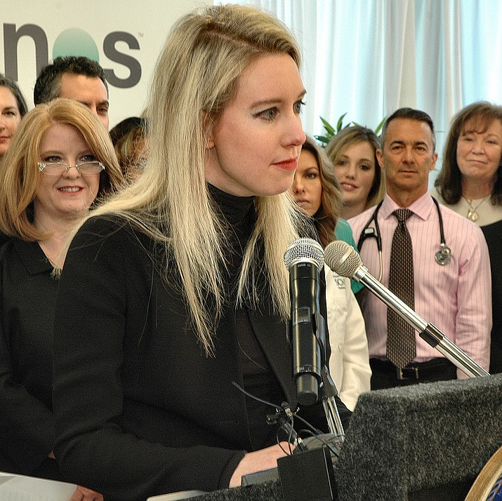 Elizabeth Holmes talks with reporters in 2015 after Gov. Doug Ducey signed legislation she promoted to allow Arizonans to order their own blood tests, a change that benefitted Theranos, her company. (Howard Fischer/Capitol Media Services, file)
