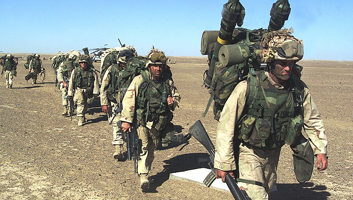 U.S. Marines march through Afghanistan in November, 2001. The 20-year war – the longest in U.S. history – is over after U.S. troops completed their withdrawal on Tuesday, Aug. 31. (U.S. Marine Corps photo/Public domain)
