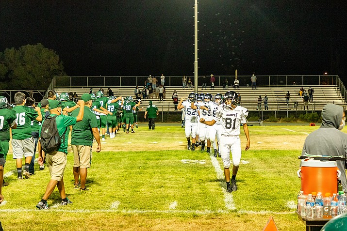 Because of COVID-19 concerns and guidelines, teams did not give the celebratory hand slap at the end of the Aug. 27 game against Whitehorse High School Raiders. (Gilbert Honanie/NHO)
