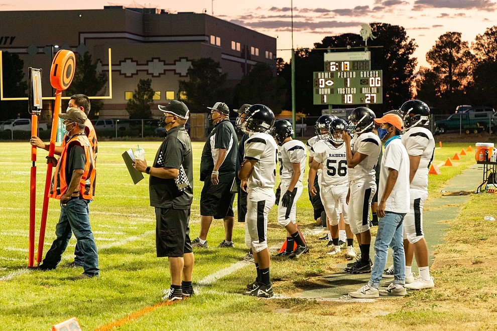 """An announcement by announcer Mike Sixkiller asked """"everyone to please follow the COVID guidelines setup by the schools, AIA, and the Navajo Nation so that future games can continue during this pandemic"""" prior to the Aug. 27 game in Tuba City. (Gilbert Honanie/NHO)"""
