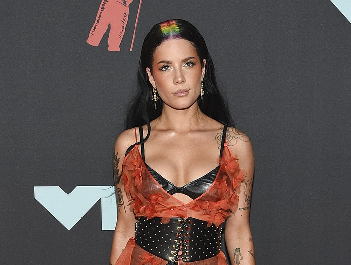"""The 13-track """"If I Can't Have Love, I Want Power"""" sees Halsey teaming up with Trent Reznor and Atticus Ross of the rock band Nine Inch Nails. Released by Capitol Records.  Tracks: 'The Tradition', 'Bells in Santa Fe', 'Easier than Lying', 'Lilith', 'Girl is a Gun', 'You asked for this', 'Darling', '1121', 'honey', 'Whispers', 'I am not a woman, I'm a god', 'The Lighthouse', and 'Ya'aburnee'. AP photo"""