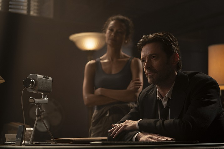 'Reminiscence,' starring Hugh Jackman, Rebecca Ferguson, Natalie Martinez,  Thandiwe Newton and Daniel Wu, is a Warner Bros. release, rated PG-13 by the Motion Picture Association of America. AP photo.