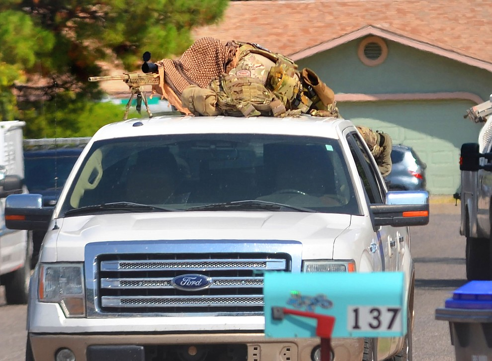 A Verde Valley SWAT officer lays down on top of a truck on the 100 block of South 9th Street on Thursday morning, Sept. 2, 2021, after several-hour standoff ended in the arrest of 33-year-old Cottonwood resident Devin Lee Sprecher. (Vyto Starinskas/Independent)