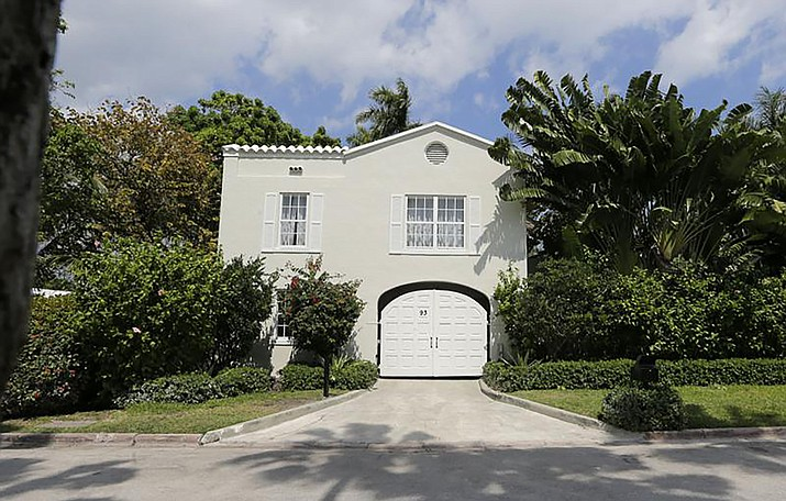 The gate house entrance of the waterfront mansion once owned by gangster Al Capone in Miami Beach, Fla., Wednesday, March 18, 2015. The South Florida house that Capone owned for nearly two decades, and died in, is facing demolition plans. The Miami Herald reported Thursday, Sept. 2, 2021 that the new owners of the nine-bedroom, Miami Beach house plan to demolish it after buying it for $10.75 million this summer. (Alan Diaz/AP file)