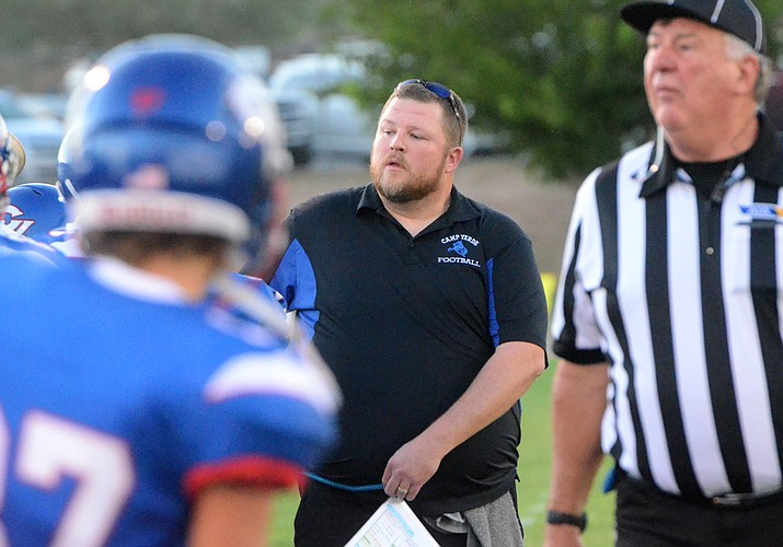 Camp Verde head coach Rick Walsworth walks the sidelines during a game against Valley Lutheran on Aug. 27, 2021. The Cowboys lost to Holbrook, 19-8, in Week 2 action Friday, Sept. 3. (Vyto Starinskas/Independent, file)