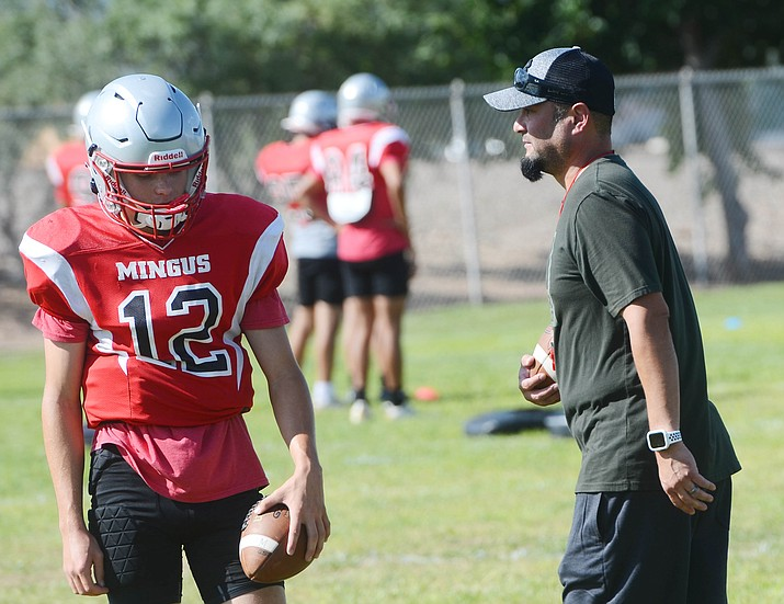Mingus interim head coach Dave Moncibaez works with quarterback Zach Harrison (12) during practice Aug. 25, 2021. Harrison threw for 135 yards and two touchdowns in a 48-25 loss to Thunderbird on Friday, Sept. 3, in Phoenix. (Vyto Starinskas/Independent, file)
