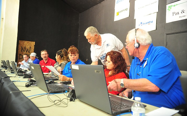 Pictured here in 2018, Kiwanis Club member Carl Mueller gives some last-minute instructions to volunteers manning the phone bank during the annual auction. The club continues its tradition for the 73rd year with a charity auction, Sept. 8-17, 2021. (Courier file photo)