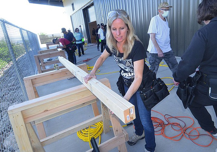 Melissa Hardwick of Cottonwood cuts a stud after a morning lecture at the Yavapai College Skilled Trades Center in Clarkdale at Yavapai College Aug. 28. (Vyto Starinskas/Verde Independent)