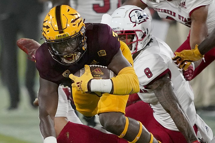 Arizona State running back Rachaad White is tackled by Southern Utah linebacker La'akea Kaho'ohanohano-Davis (8) during the first half of an NCAA college football game, Thursday, Sept. 2, 2021, in Tempe. (Matt York/AP)