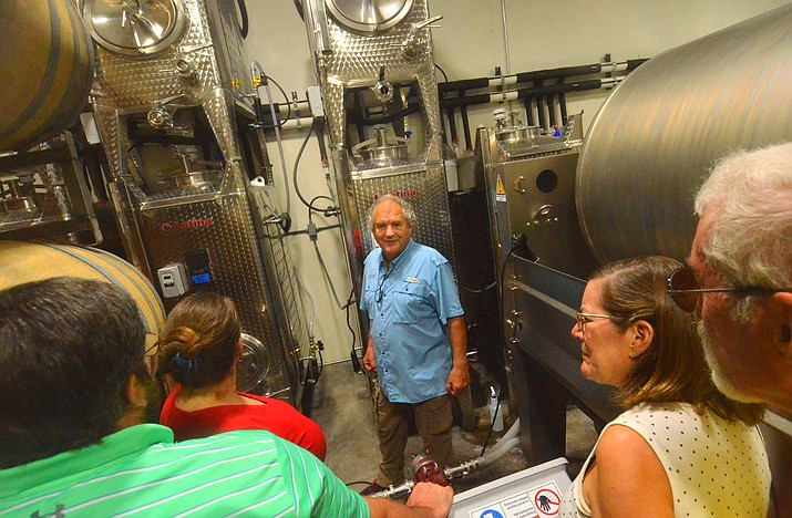 People take a tour inside the Cove Mesa Vineyard in Cottonwood on Saturday, Sept. 4, 2019.  (Vyto Starinskas/Independent)