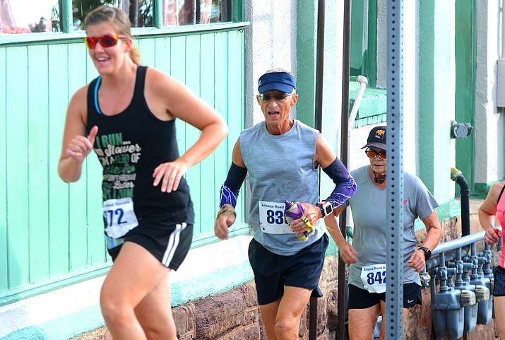 The historic Jerome Hill Climb went off on time early Sunday morning, Sept. 5, 2021, at the entrance of the Jerome Historical Museum as runners began the climb of the grueling, traditional 4.5-mile race. (Vyto Starinskas/Independent)