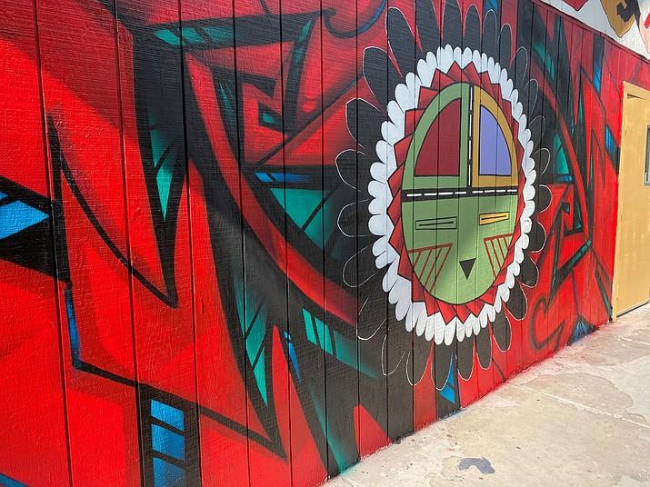 A painting of the Hopi Sun on a mural at the Murdoch Community Center in Flagstaff, Arizona features work by Hopi/Tewa artist Duane Koyawena and Tohono O'odham artist Dwayne Manuel.  (Photo courtesy of Duane Koyawena)
