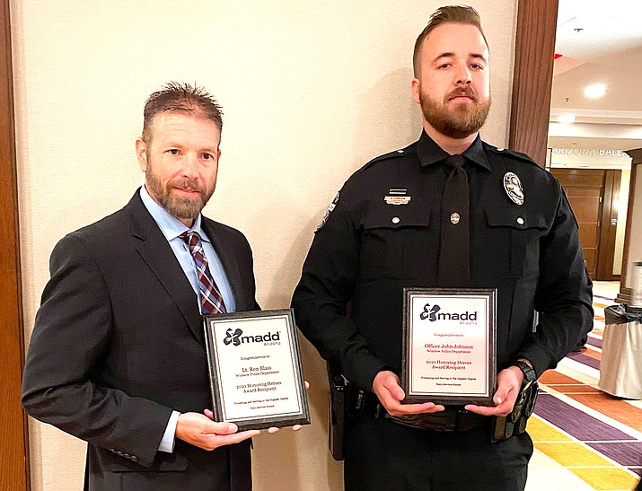 Lieutenant Blass and Officer Johnson with the Winslow Police Department were recently recognized with an award at the annual MADD (Mothers Against Drunk Driving) banquet in Scottsdale.(Photo/City of Winslow)