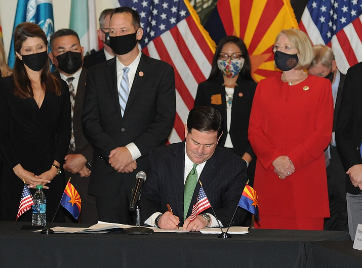 Gov. Doug Ducey signing the new gaming compacts in April 2021 with tribes as part of a deal to allow statewide gambling on professional and college sports. (Howard Fischer/Capitol Media Services, file)