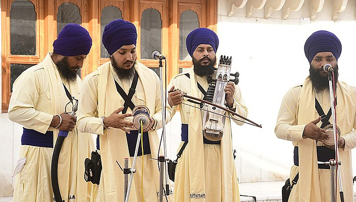 Twenty years after the Sept. 11 terror attacks on the United States, Sikhs living in the U.S. are still struggling with discrimination. Sikh folk singers are pictured. (Photo by Shagil Kannur, cc-by-sa-4.0, https://bit.ly/3tqSLEH)