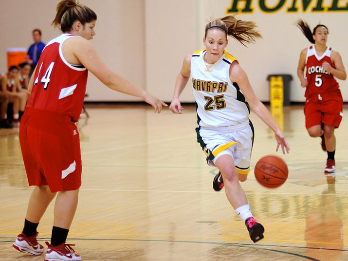 In this undated photo, a Yavapai College women's basketball player (25) dribbles down the court. (Yavapai Athletics/Courtesy)