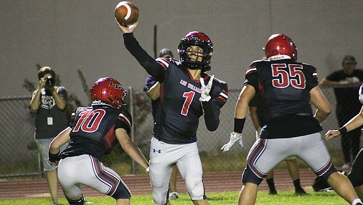 Lee Williams quarterback Devean Santos fires a pass during Lee Williams' 18-13 loss to Northwest Christian on Sept. 3. The Volunteers travel to play Lake Havasu High School on Sept. 10, while Kingman will host Kingman Academy. Both games kick off at 7 p.m. (Photo by Travis Rains/Kingman Miner)