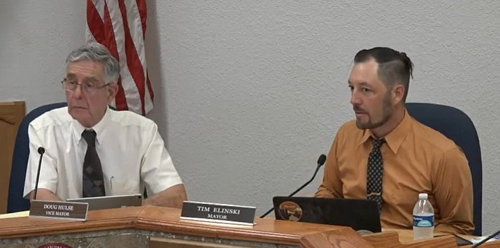 Cottonwood Mayor Tim Elinski looks at the city council during their regular meeting Tuesday, Sept. 7, 2021, after reading the consent agenda, of which one item included approved continuing funding for a K-8 water conservation program at local schools. The city council unanimously approved. (City council meeting screenshot)