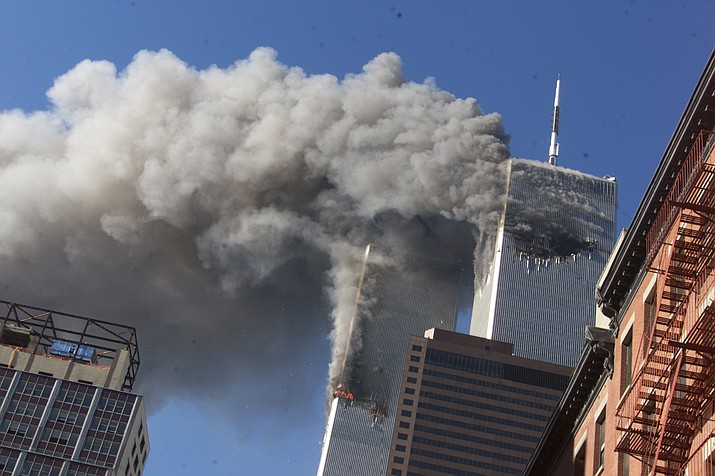 Smoke rises from the burning twin towers of the World Trade Center after hijacked planes crashed into the towers on Sept. 11, 2001, in New York City. The Sedona Police and Fire departments are scheduled to host a remembrance ceremony Saturday, Sept. 11, 2021. (Richard Drew/AP, file)