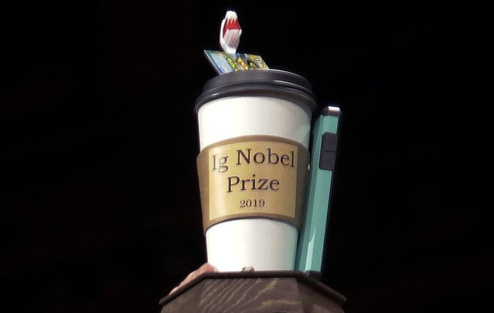 In this Sept. 12, 2019 photo, the 2019 Ig Nobel award is displayed at the 29th annual Ig Nobel awards ceremony at Harvard University in Cambridge, Mass. The spoof prizes for weird and sometimes head-scratching scientific achievement will be presented online in 2021 due to the coronavirus pandemic. (Elise Amendola/AP, File)