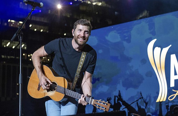 In this Tuesday, August 24, 2021 photo, Brett Eldredge performs at the 2021 ACM Party for a Cause at Ascend Amphitheater, in Nashville, Tenn. Eldredge has had another encounter with wildlife, this one involving a bear at a North Carolina home. The bear entered a garage at a home in Asheville, N.C., as Eldredge was about to go on a hike, The Charlotte Observer reported. (Amy Harris/Invision/AP, File)