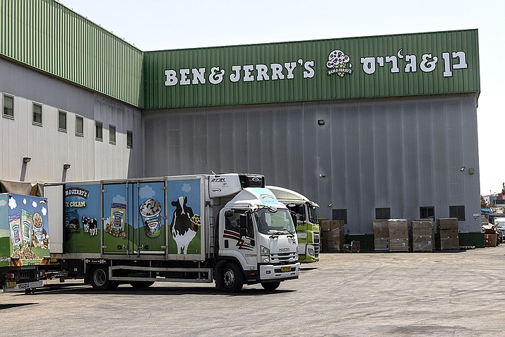 In this July 20, 2021, file photo, truck sare parked at the Ben & Jerry's ice-cream factory in the Be'er Tuvia Industrial area in Israel. The state of Arizona has sold off $93 million in Unilever bonds and plans to sell the remaining $50 million it has invested in the global consumer products company because its subsidiary Ben & Jerry's decided to stop selling its ice cream in Israeli-occupied territories in the latest in a series of actions by states with anti-Israel boycott laws. (Tsafrir Abayov, AP File)