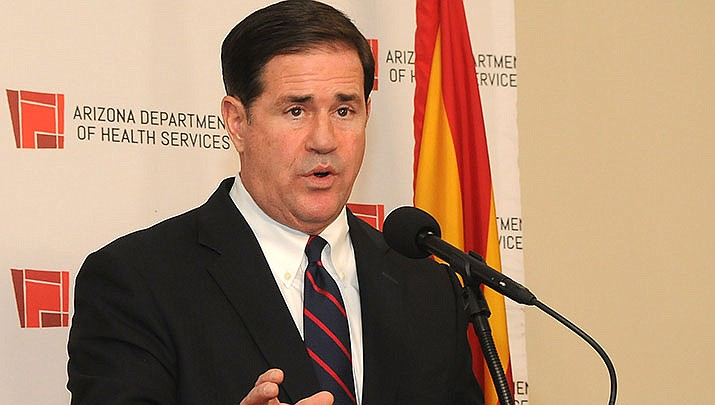 Arizona Gov. Doug Ducey promised to push back against plans by the Biden administration to require businesses with 100 or more employees to mandate vaccines or frequent COVID-19 testing for employees. (File photo by Howard Fischer/For the Miner)