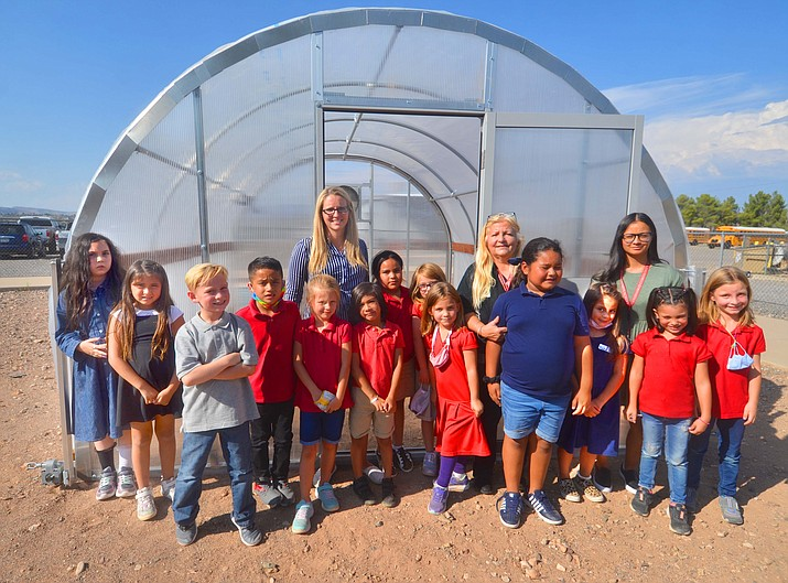 Cottonwood Community School students in the Permaculture Club stand in front of their brand-new greenhouse. (Vyto Starinskas/Independent).