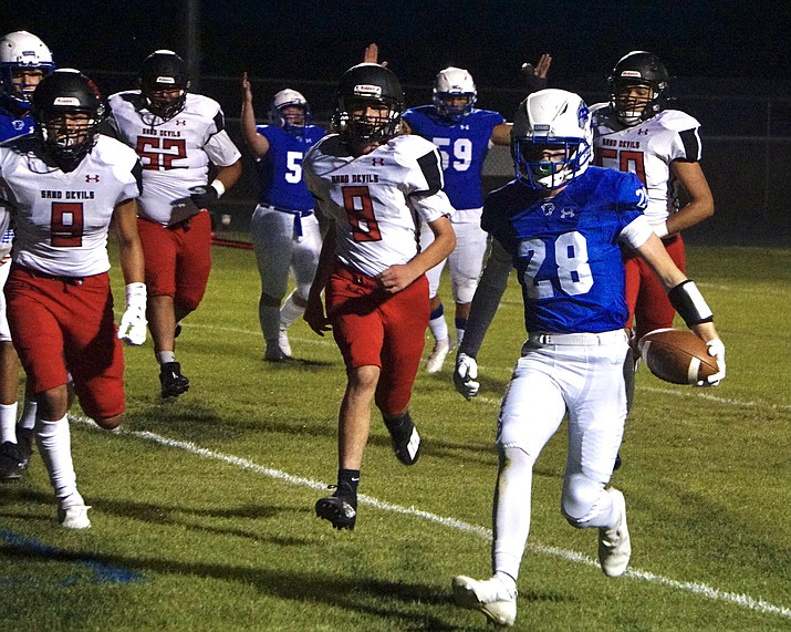 Chino Valley running back Johnny Parrish (28) runs the ball into the end zone for a touchdown during a game against Page on Thursday, Sept. 9, 2021, at Cougar Stadium in Chino Valley. (Aaron Valdez/Courier)