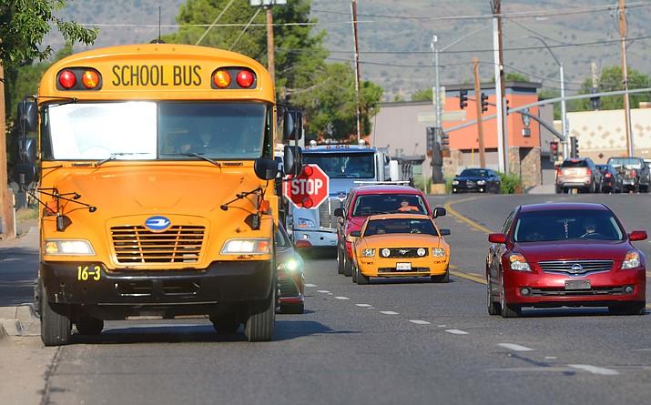 A Cottonwood-Oak Creek School District school bus picks up students Thursday, Sept. 9, 2021, in Bridgeport. (Vyto Starinskas/Independent)