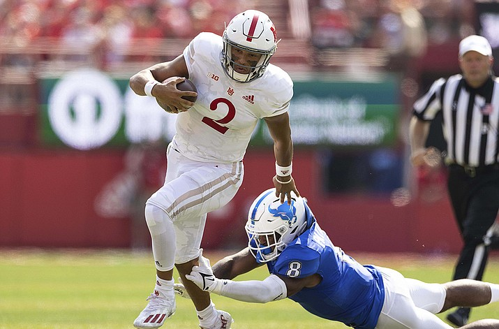 Nebraska quarterback Adrian Martinez (2) carries the ball against Buffalo's James Patterson (8) during the first half of an NCAA college football game, Saturday, Sept. 11, 2021, at Memorial Stadium in Lincoln, Neb. (Rebecca S. Gratz/AP)