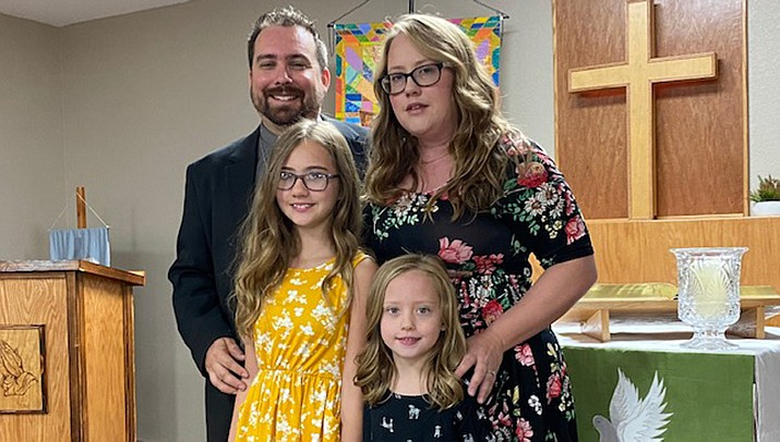 Brandon Scroggins, rear left, has been hired as the first full-time pastor at the Living Word Lutheran Church in Kingman. He is pictured with his wife, Yivette, and daughters Adalyn, 11, and Elodie, 7. (Courtesy photo)