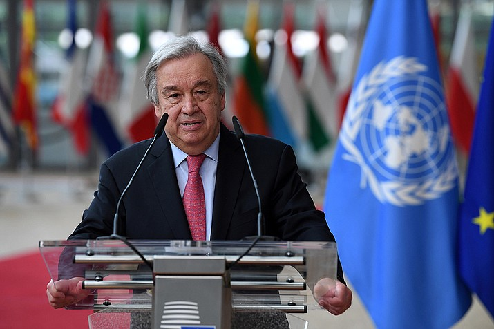 """In this June 24, 2021 file photo, United Nations Secretary General Antonio Guterres addresses journalists during an EU summit at the European Council building in Brussels.  Guterres has issued a dire warning, Saturday, Sept. 11,  that the world is moving in the wrong direction and faces """"a pivotal moment.""""  (John Thys, Pool Photo via AP, File)"""