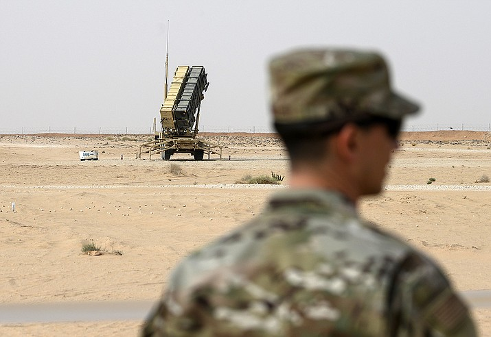 In this Feb. 20, 2020, file pool photo, a member of the U.S. Air Force stands near a Patriot missile battery at Prince Sultan Air Base in Saudi Arabia. The U.S. has removed its most advanced missile defense system and Patriot batteries from Saudi Arabia's Prince Sultan Air Base in recent weeks, even as the kingdom faced continued air attacks from Yemen's Houthi rebels, satellite photos analyzed by The Associated Press show. (Andrew Caballero-Reynolds/Pool via AP, File)