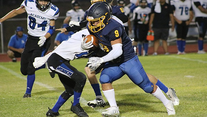 Nick Williams-Garcia, above, rushed for 205 yards and Malakai Bell gained 202 yards to lead the Kingman Bulldogs to a lopsided 68-0 win over Kingman Academy in a high school football game on Friday, Sept. 10. It was the first homecoming win for Kingman in the past 19 years. (Photo by Travis Rains/Kingman Miner)