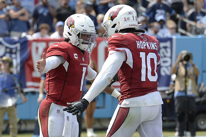 Arizona Cardinals quarterback Kyler Murray (1) is congratulated by wide receiver DeAndre Hopkins (10) after Murray ran for a touchdown against the Tennessee Titans in the first half of an NFL game Sunday, Sept. 12, 2021, in Nashville, Tenn. (Mark Zaleski/AP)