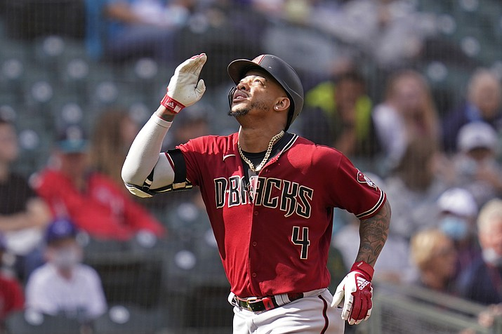 Arizona Diamondbacks' Ketel Marte motions as he heads home on his solo home run against the Seattle Mariners in the seventh inning of a game Sunday, Sept. 12, 2021, in Seattle. (Elaine Thompson/AP)