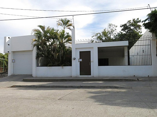 """This Feb. 23, 2014 photo shows one of the properties that was interconnected by tunnels in the drainage system which the infamous drug kingpin Joaquin Guzman Loera known as """"El Chapo"""" used to evade authorities through an escape hatch in Culiacan, Mexico. In addition to properties seized from other previous owners, Mexico's lottery is giving away this property on Wednesday, Sept. 15, 2021. (Adriana Gomez/AP, File)"""