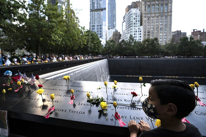 Members of the public arrive to the south pool after the conclusion of ceremonies to commemorate the 20th anniversary of the Sept. 11 terrorist attacks, Saturday, Sept. 11, 2021, at the National September 11 Memorial & Museum in New York. (AP Photo/John Minchillo)