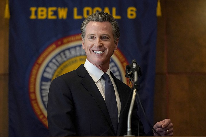 Gov. Gavin Newsom speaks to volunteers in San Francisco, Tuesday, Sept. 14, 2021. The recall election that could remove California Democratic Gov. Newsom is coming to an end. Voting concludes Tuesday in the rare, late-summer election that has emerged as a national battlefront on issues from COVID-19 restrictions to climate change. (Jeff Chiu/AP)
