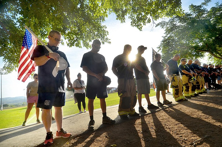 The community met on the Cottonwood Community School's track field for a 9-11 Remembrance Walk on the attack's 20th anniversary Saturday, Sept. 11, 2021. (Vyto Starinskas/Independent)